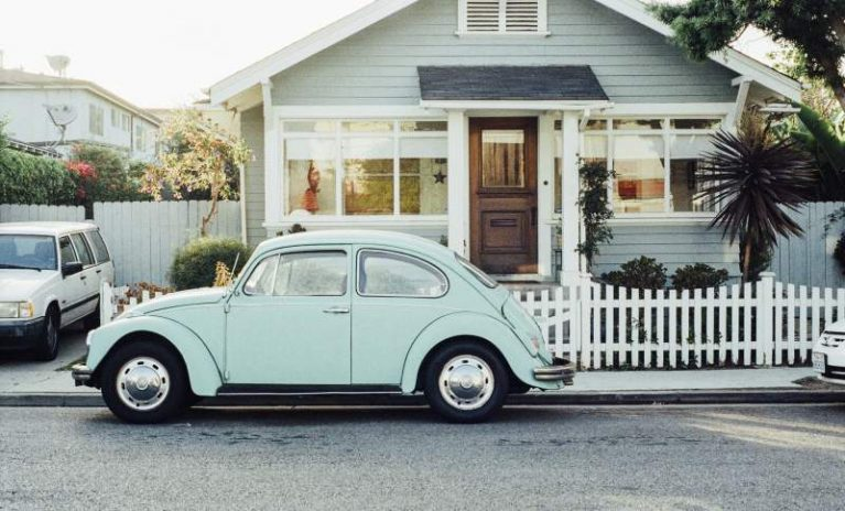 House with vintage car