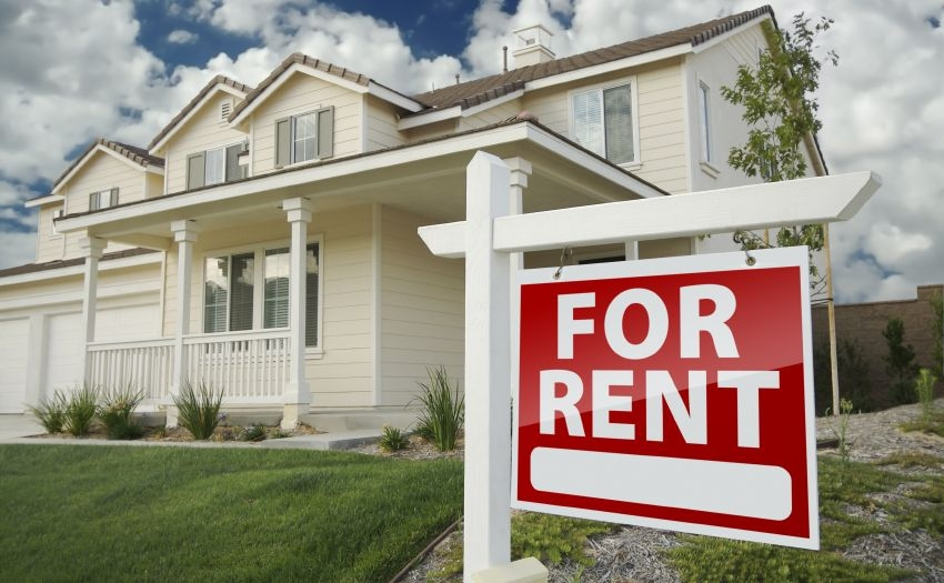 Home exterior with For Rent sign