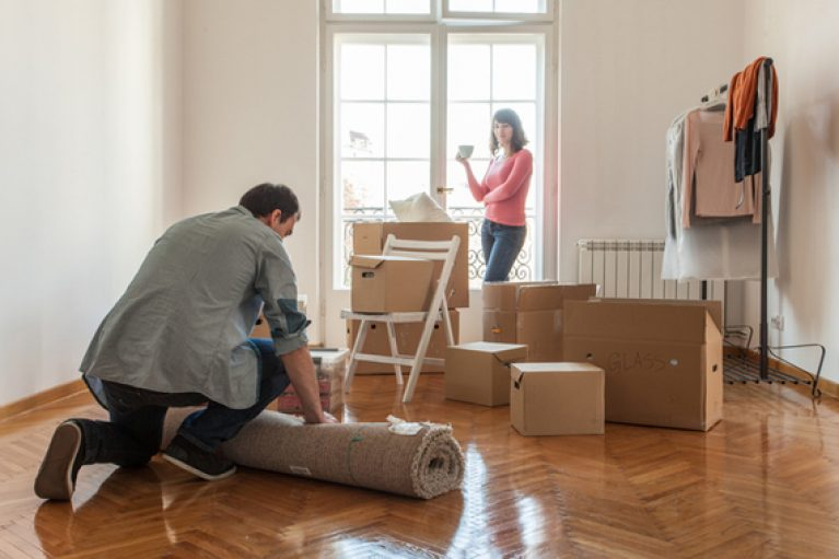 Couple packing up home
