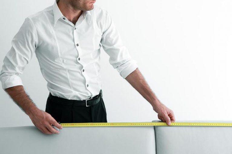 Man measuring sofa